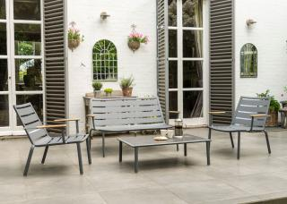 This contemporary aluminium lounge set comes in two colours with a choice of hardwood or HPL table top.