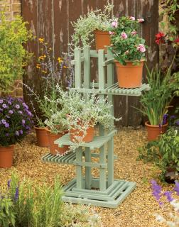 A painted eucalyptus plant stand which can be used inside or out.
