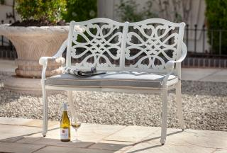 This neutral cast aluminium bench for two is finished in Royal White with a Weatherready® cushion in Pewter.
