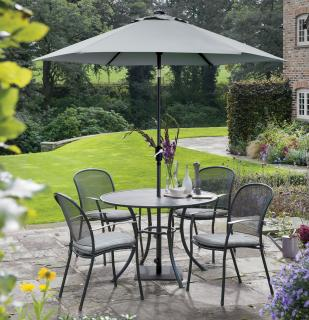 The Caredo 4 Seater Set is durable and maintenance free & comes with cushions in Silver Check & parasol in Silver.