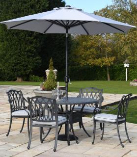 A decorative cast aluminium set with parasol & base finished in antique grey with Weatherready® cushions in platinum.