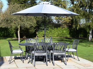 A limited edition range of decorative cast aluminium furniture finished in antique grey with Weatherready® cushions in platinum.