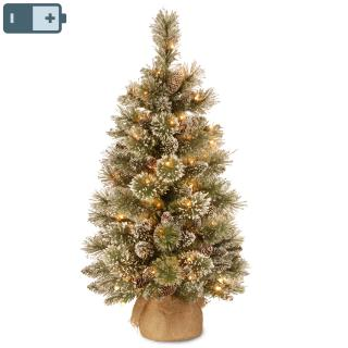 This attractive pre-lit 3ft tree has battery operated lights & a hessian covered base.