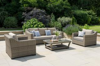 This chunky resin weave sofa set in Camel has an attractive curved design & comes with ALL WEATHER cushions in Khaki.
