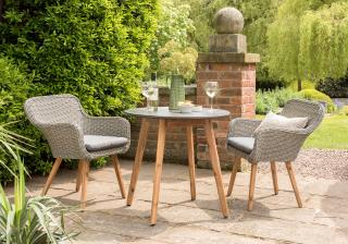 An attractive mixed media dining set for two with Acacia legs, woven chairs & poly-cement table top.