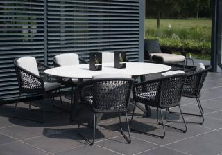 An eye-catching oval dining set with a ceramic marble table top on an angled aluminium base with woven dining chairs in anthracite nylon rope.