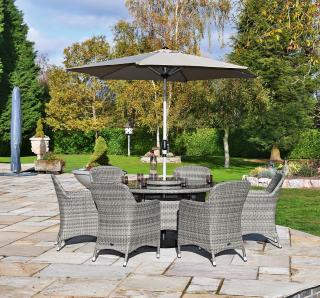 A spacious 1.4m resin weave dining set for six with a parasol & base.