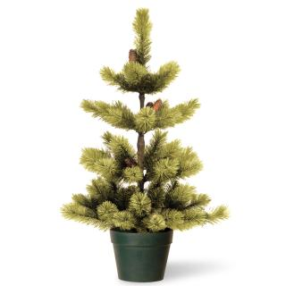 This potted artificial tree has a classic pine tree design.