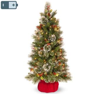 This 4ft Wintry Pine pre-lit Christmas tree is decorated with cones, red berries & snow & will light up any corner.