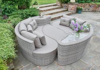This set offers a little bit of everything, transforming from a footstool & sofas housing integral tables to create this stunning curved daybed.