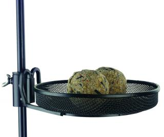 A Bird Feeding Tray to enhance the capabilities of bird seed feeders and help keep the bird food off the ground.