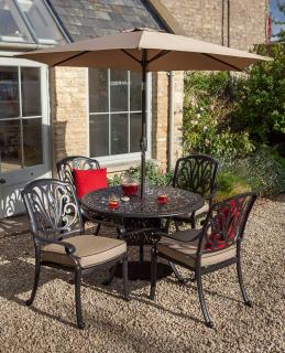 A cast aluminium garden set finished in bronze with Weatherready® cushions in fawn.