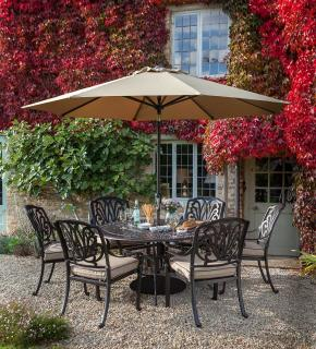 A cast aluminium 6 seater set finished in bronze with Weatherready® cushions in fawn.