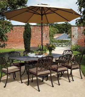 A cast aluminium, rectangular garden set finished in bronze with Weatherready® cushions in fawn.