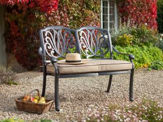 A comfortable cast aluminium bench finished in bronze with a Weatherready® cushion.