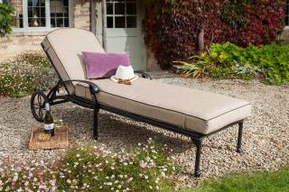 Price drop this weekend only. A cast aluminium garden lounger finished in bronze with a deep Weatherready® cushion in fawn.