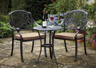 A cast aluminium bistro set finished in bronze with Weatherready® cushions in fawn.