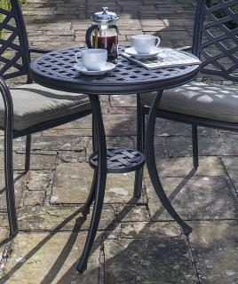 A cast aluminium table which is ideal for a small space, it comes finished in bronze.