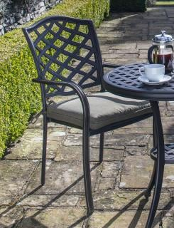 A cast aluminium chair which is ideal for a small space, it comes finished in bronze with an olive seat pad.