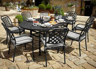 A large cast aluminium set for eight in Midnight black with Shadow grey accessories.
