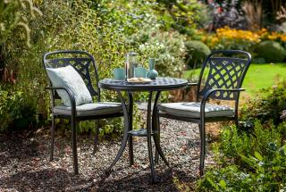 A Midnight black cast aluminium set with Shadow grey cushions which is ideal for a corner of the patio or balcony.