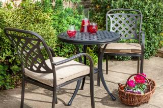 A bronze cast aluminium set with Weatherready® cushions which is ideal for a corner of the patio or balcony.