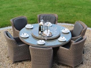 A generous Hularo Weave dining set with padded all weather cushions.