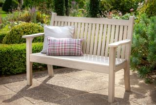 A POLYWOOD® lumber 2 seater garden bench made from recycled materials with a Parchment finish.