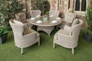 A generous Hularo Weave dining set with padded all weather cushions, parasol & base.