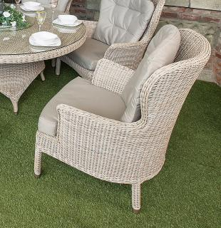 A comfortable Hularo Weave dining chair with all weather cushions.