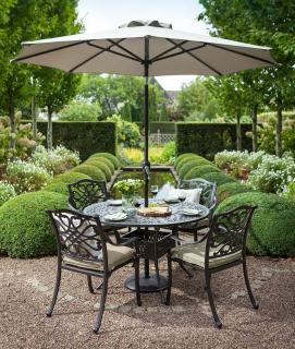 A cast aluminium garden set for four finished in bronze with Weatherready® cushions in Wheatgrass.