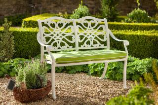 This bright cast aluminium bench for two is finished in Royal White with a Weatherready® cushion in Lime.