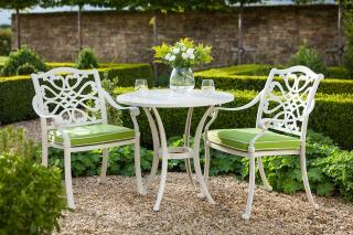 A colourful cast aluminium bistro set finished in Royal White with Weatherready® cushions in Lime.