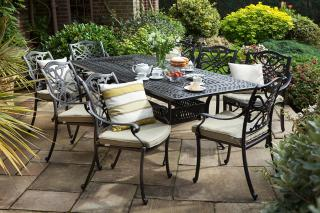 A 2.1m cast aluminium garden set finished in bronze with Weatherready® cushions in Wheatgrass.