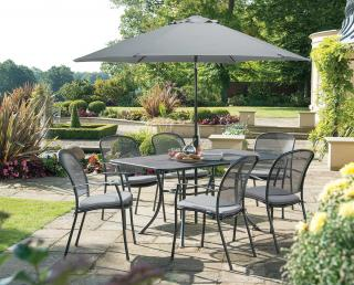 The Caredo 6 Seater Rectangular Set is durable and maintenance free & comes with cushions in Silver Check & parasol in Silver.