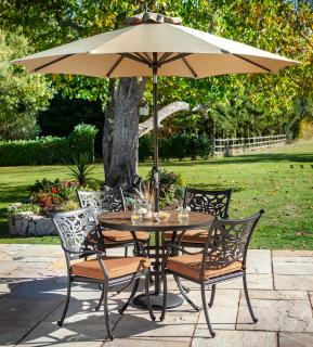 A decorative cast aluminium set for four, finished in bronze with a painted concrete table top & matching Weatherready® seat cushions in Pumpkin.