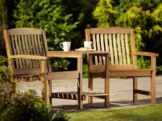 A hardwood 2 seater garden bench with integral table.