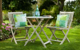 A folding hardwood 2 seater garden furniture set which folds away for easy storage & has a painted Kiwi finish.