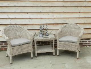 A generous Hularo Weave bistro set with all weather seat cushions.
