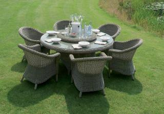 A curved Hularo Weave dining set for 6 with all weather seat cushions. Lazy Susan available separately.