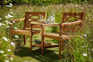 An attractive COC hardwood 2 seater garden set with integral table.