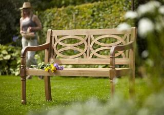 A hardwood 2 seater garden bench.
