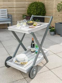 This grey painted eucalyptus drinks trolley makes it simple to take food out into the garden.