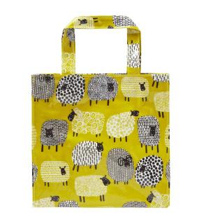 This wipe clean mustard coloured bag has a magnetic clasp for closing and an inner pocket with a zip.