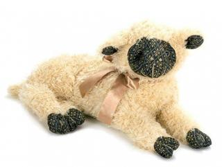 Liddy Lou Lambkin Doorstop just looks like she is resting against the door. Code DS150.