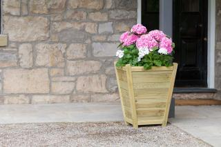 The sophisticated Eaton Planter will make a great entrance to a front porch or a fabulous feature within the garden.