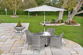 An attractive resin weave dining set for four with a parasol & base.