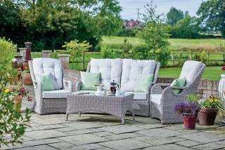 This attractive, resin wicker set brings the comfort of indoors out to the garden or patio.