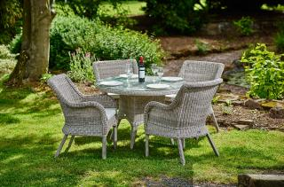 This classic resin wicker set has a round dining table with a glass top & armchairs complete with seat cushions.
