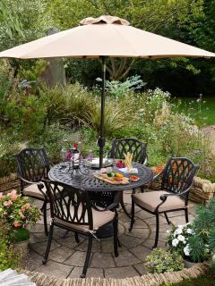 A decorative cast aluminium set with parasol & base finished in bronze with Weatherready® cushions in Amber.